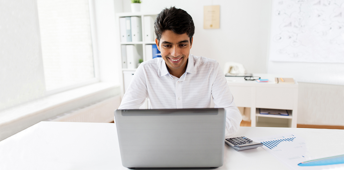 accountant with laptop and papers at office